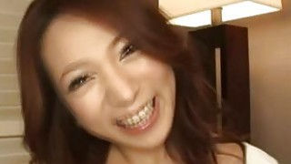 Naughty Japanese housewife kneels on the floor to blowjob image