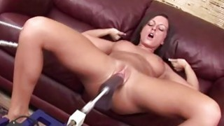 Busty brunette plays with fucking machine image