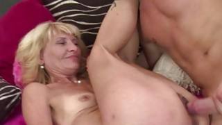 Slim mature gets drilled by a young stud image