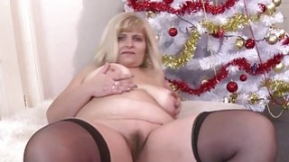 Chubby mature fingering and toying her pussy image