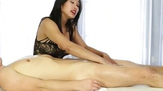 Oriental masseuse blowjobs clients cock under the table image