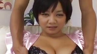 Meguru gets her big Asian tits fondled before a fuck image