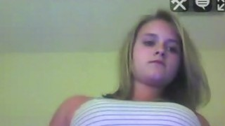 Blonde teen do sexy a show on the_webcam, and starting undressing image