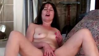 Image: Brunette American mature dildoing herself