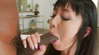 Big Black cock drilling an Asian anal balls deep image