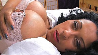 Busty_black_mature_teasing_on_a_bed image