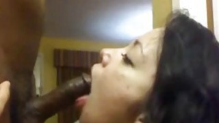 Horny latina milf eating a bbc on webcam image