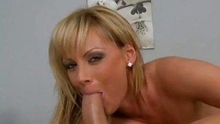 Image: Doxy stands down on her knees to suck beefy pecker