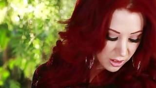 Juicy Redhead has orgasms in her backyard image