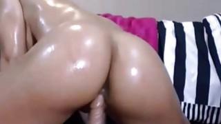 Image: Big round oiled ass dildo riding