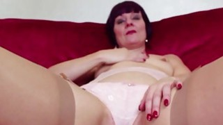 Redhead mature masturbating in stockings image