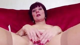 Redhead_mature_masturbating_in_tan_stockings image