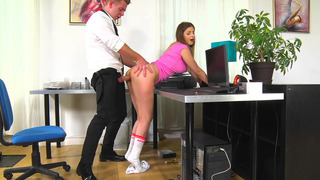 Image: Stella Cox bends over the desk and gets her moist snatch slammed