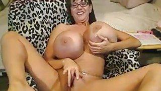 Image: Mature with_big silicone tits masturbates on webcam