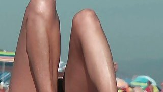 Nude spy cam on the beach with a black hair goddess in focus image