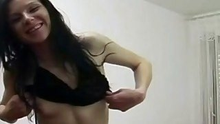 Skinny brunette amateur in boots is masturbating with her favorite sex toys image