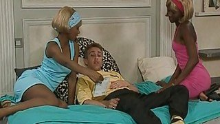 Image: Couple of horny black bitches suck white dick and get their chocolate pussies nailed on bed