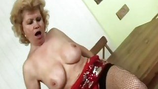 Smooth busty granny inserting two fingers in her wrinkled pussy as foreplay with lover boy image