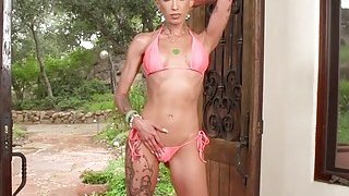 Image: Tattooed blonde twerks huge butt
