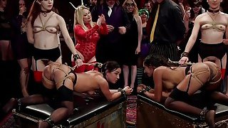 Group of hot slaves serving at kink ball image