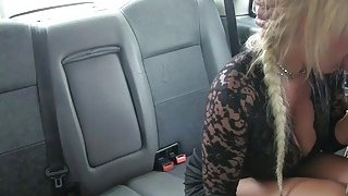 Busty blond mature fucked by the driver to off her fare image