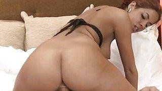 Bawdy pornstar rides on a wang image