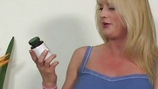 A big tit blonde MILF hallucinating that she is riding a large black cock image