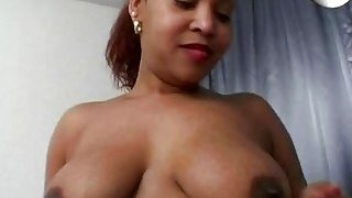 Chubby black chick playing with dildo in bedroom image