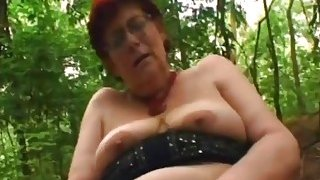 Sex crazed granny Tamara greedily sucks hard dick and gets fucked in park image