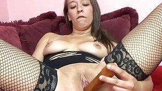 Nicci Taylor lifts_her dress and fucks_her twat image