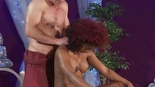 A very hot redhead ebony babe with_perfect body sucks masseur's dick and gets pussy fucked image