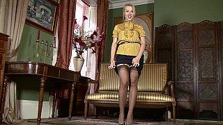 Skirt-wearing MILF seducing image