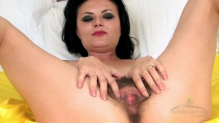 Image: Amazing MILF teases with her hairy cunt and masturbates solo