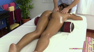 Cute Asian babe gets her tied cunt oiled and massaged image