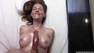 Beautiful MILF sucks and titty-fucks her black lovers monster cock image