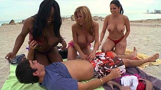 Beach MILFs seduce a young guy image