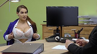 Busty brunette gives a titjob to get a loan image