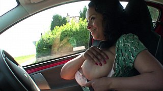 Topless driving with a MILF image