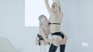 Seductive blonde lesbians in latex play with big sex toys image