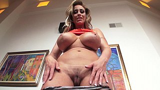 Busty blonde MILF finds a dick to suck image