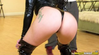 Phat ass babe in latex face sits on horny hunks image
