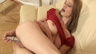 Skinny blonde Laura Milk Enema in red outfit penetrates her pussy with metal dildo image