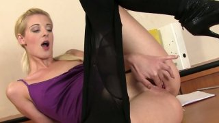 Horny blonde Mia Hilton pulls_off her pantyhose and fingers_herself image