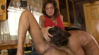 Busty milf Deauxma gives blowjob to young guy next door image