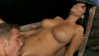 Dirty slut Veronica Rayne is doing a titsjob and sucking on a dick really good image