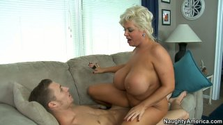 Blonde whore Claudia Marie with popout, huge boobs rides on cock image