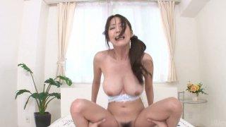 POV video of chubby brunette Akari Asagiri riding cock image