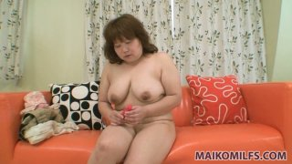 Image: Modest conservative Japanese milf Kumiko Kaga uses dildo for the first time