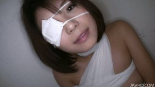 Bandaged Japanese girl Azumi Harusaki gives blowjob image