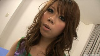 Sexy brownhead Sakura Aragaki strips on a cam and gets her small tits squeezed image